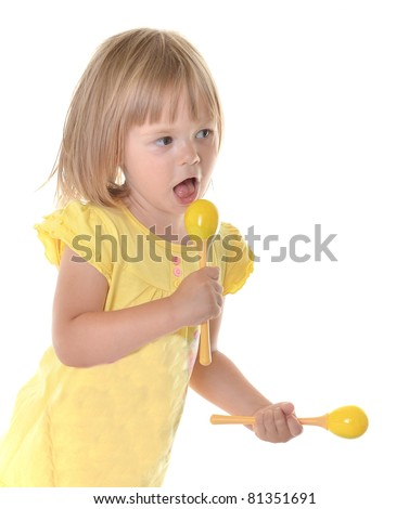baby girl with rattle - stock photo