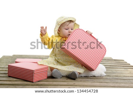 baby girl with red and white checkered suitcases, isolated on whit background - stock photo