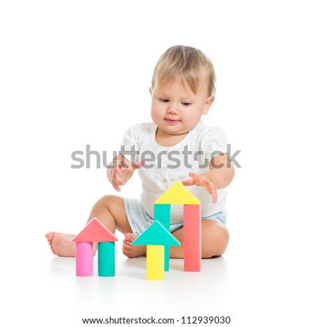 baby girl with soft puzzles isolated on white background - stock photo
