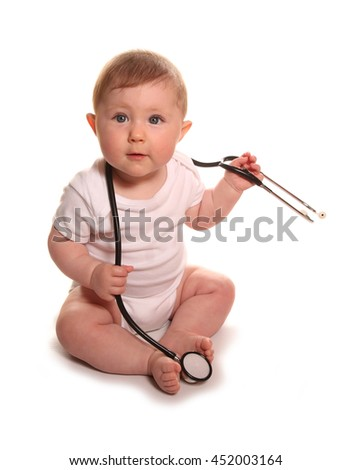 Baby girl with stethoscope studio cutout