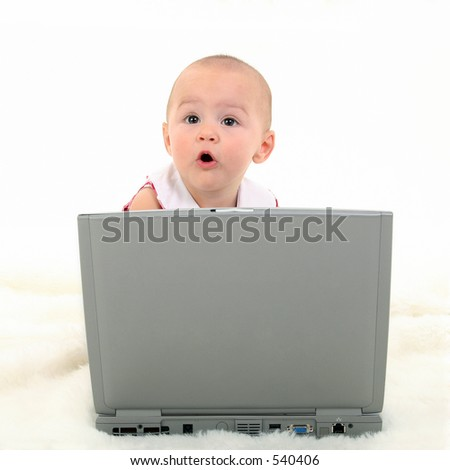 Baby girl with surprised express working on laptop. Shot in studio over white. - stock photo