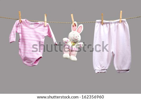 Baby girl y clothes   on the clothesline - stock photo