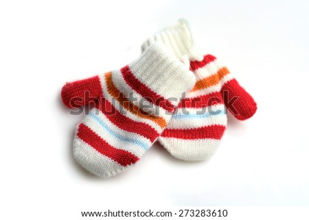 Baby gloves on white background - stock photo
