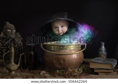 baby halloween witch with cauldron