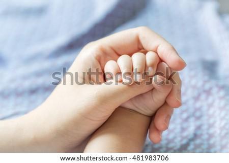Baby Hand Holding Finger
