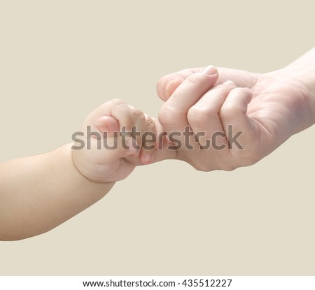 Baby hand holding mother finger.