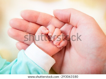 Baby hand in mother's palm
