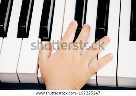 baby hand on piano