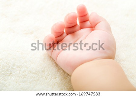 Baby hand on towel