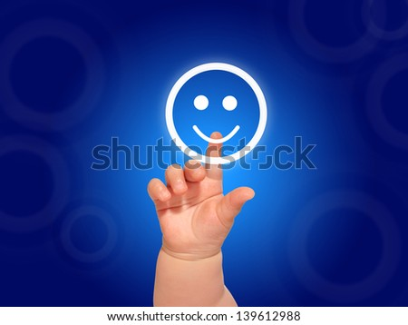 Baby hand pushing  smile button.