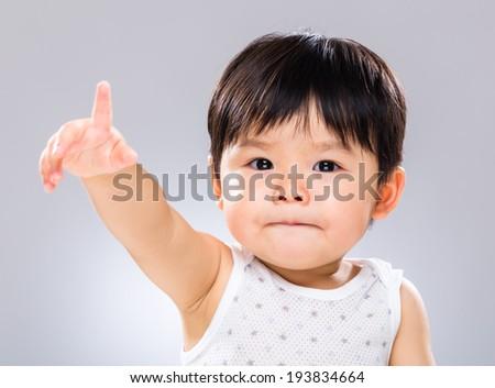 Baby hand raised up - stock photo