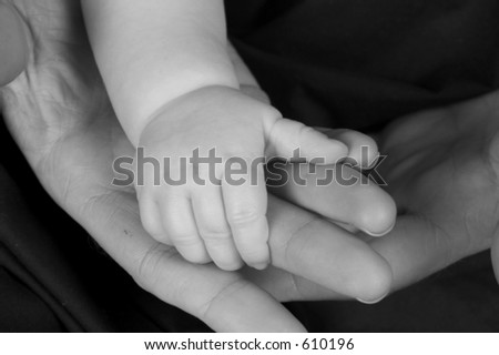baby hand resting in parent