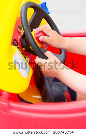 Baby hands holding a wheel
