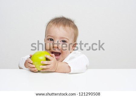 baby holding apple and shouting