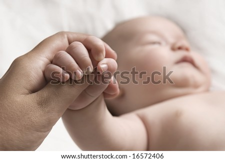 Baby holding hand