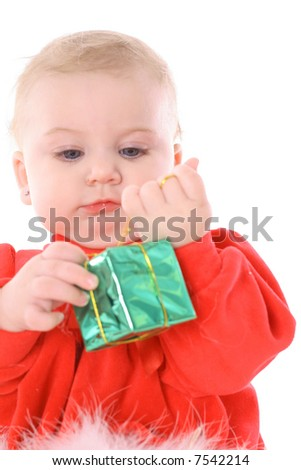 baby holding present - stock photo