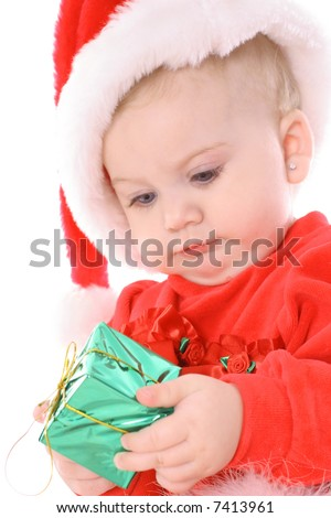 baby holding present with santa hat - stock photo