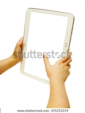 Baby holding white tablet in hands. Isolated on white  - stock photo