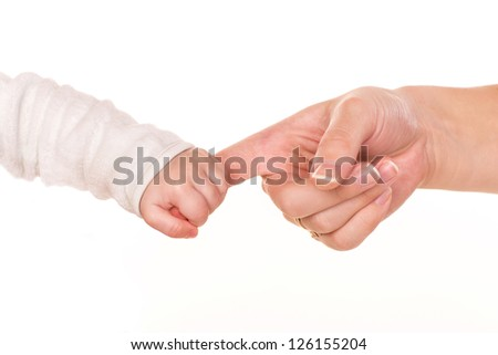 Baby holds mother's finger, trust family help concept, isolated on white background - stock photo