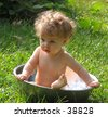 baby in a basin - stock photo