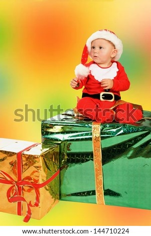 baby in a Christmas outfit