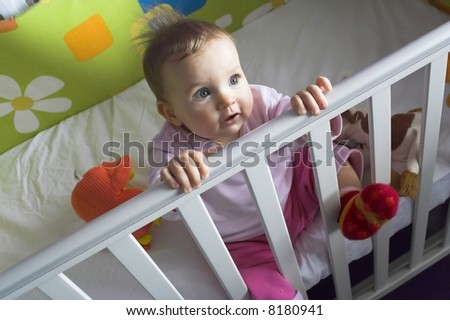 Baby  in a Crib - sitting - stock photo