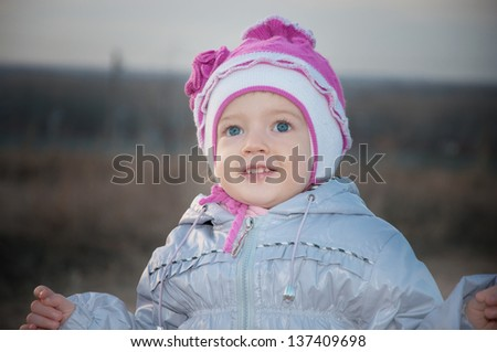 baby in a jacket and hat - stock photo