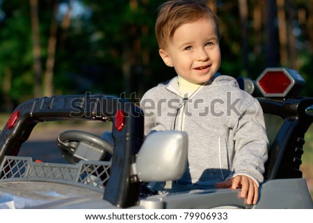 Baby in a toy car