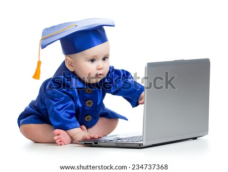 baby in academic dress works on laptop isolated - stock photo