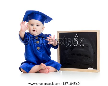Baby in academician clothes  with chalkboard - stock photo