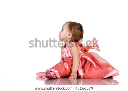 Baby in an elegant pink dress making splits. isolated on white background with clipping path