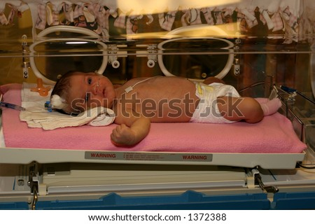 baby in an incubator at hospital ICU