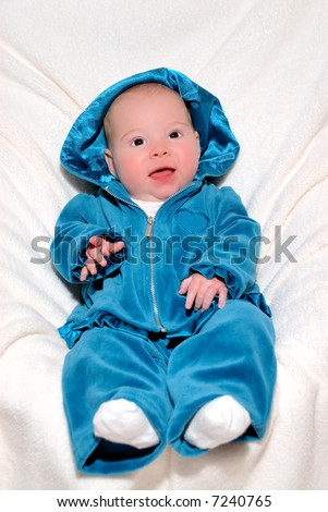 Baby In Blue - A 4 month old baby smiling and happy in a blue velour sweatsuit.