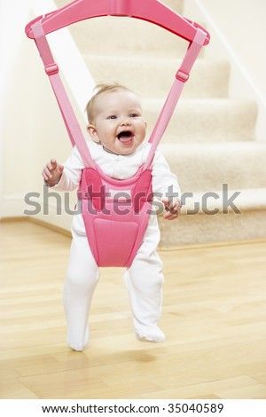 Baby In Bouncer - stock photo