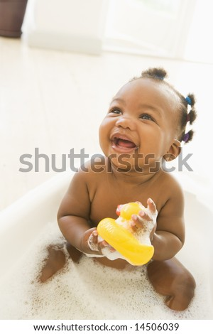 Baby in bubble bath - stock photo