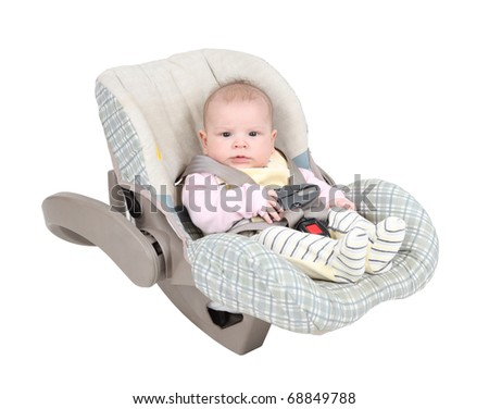 Baby in child car seat isolated over white background - stock photo