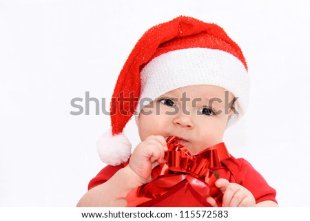 baby in Christmas bonnet looks at camera