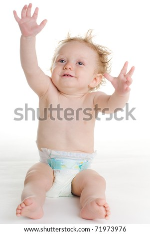 baby in diaper playing on white ground - stock photo
