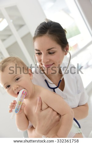 Baby in doctor's office for medical checkup - stock photo