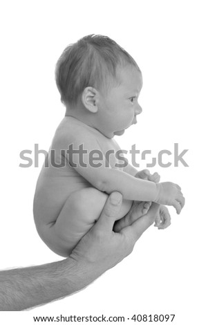 baby in father's hand isolated on white background - stock photo