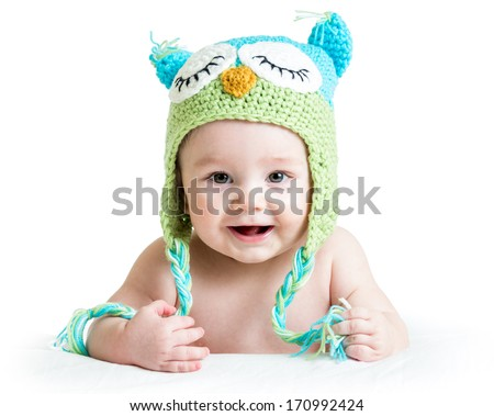 baby in funny owl knitted  hat owl on white background - stock photo