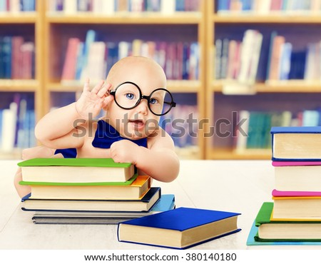 Baby in Glasses Read Books, Smart Kid Early Development and Education, Library Book Shelves - stock photo
