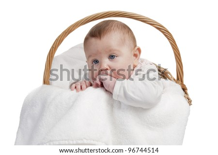baby in laundry basket, isolated on white
