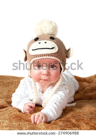 Baby in monkey hat - stock photo
