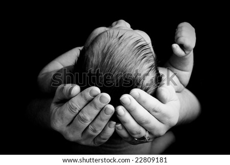 Baby in Mothers Hands 2 - stock photo