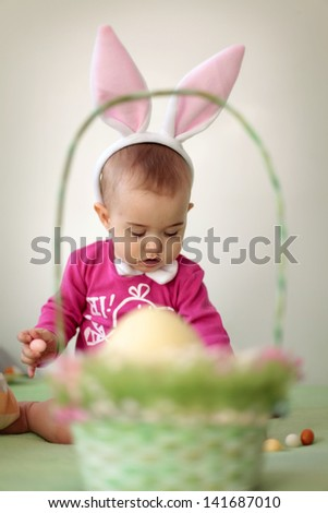 Baby in rabbit costume for Easter - stock photo