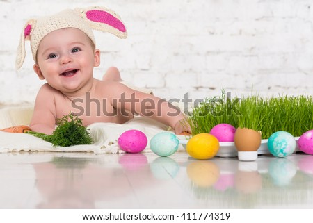 Baby in rabbit costume smiles and plays easter eggs. Fresh grass  sc 1 st  Shutterstock & Baby Rabbit Costume Smiles Plays Easter Stock Photo (Royalty Free ...