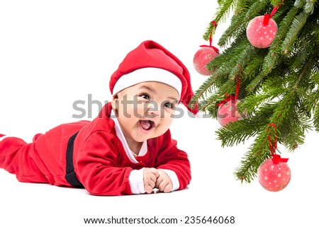 Baby in Santa costume - stock photo