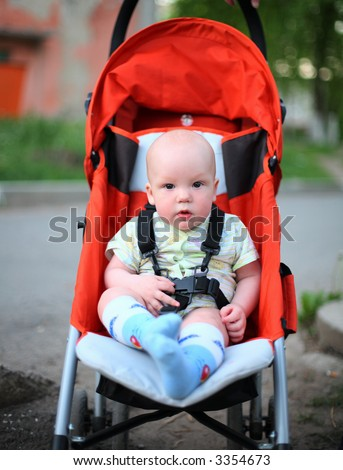 Baby in sitting stroller #6 - stock photo