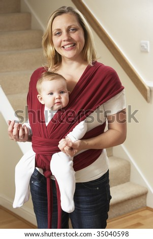 Baby In Sling With Mother - stock photo